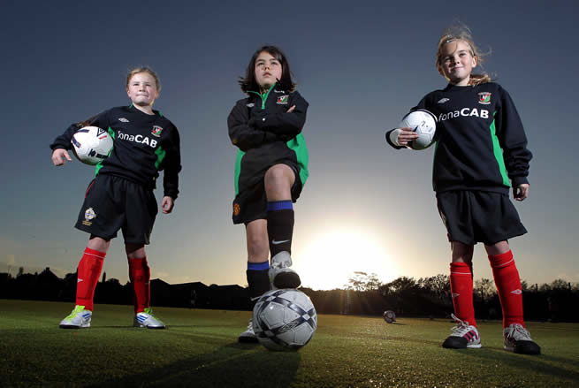 Budding young footballers Emily Wilson, Zoe Kilpatrick and Joely Andrews officially launch Glentoran Belfast United's first ever Junior Academy for Girls.