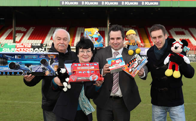 Michael Magee, Connswater Community Centre (left); Myrtle Neill, Carew II Family and Training Centre and Damien Brennan, Short Strand Community Centre (right) showcase some of their toys alongside Russell Lever, Community Relations Officer at Glentoran (centre) following the success of the inaugural Glentoran 2011 Christmas Toy Appeal